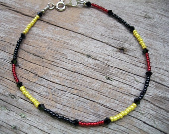 Red, Black, and Yellow Beaded Anklet