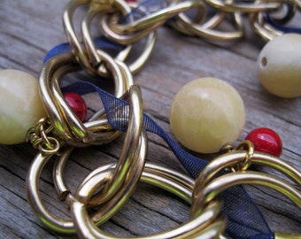 Americana Gold Charm Bracelet, Navy Ribbon, Red, Cream Color Charms