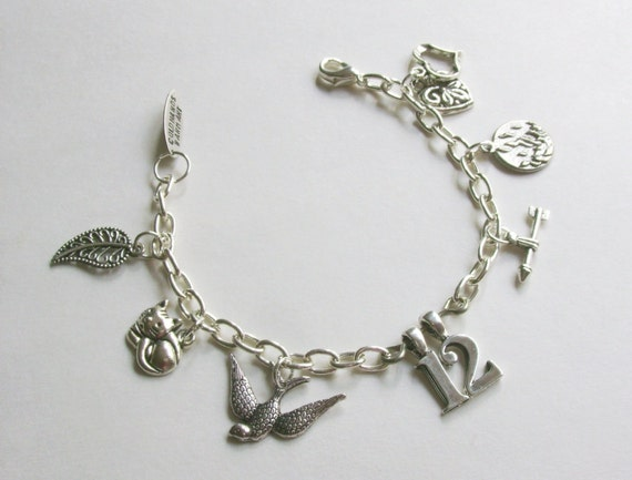 The Hunger Games charm bracelet mockingjay district 12 arrow fire inspired by The Hunger Games movie and books