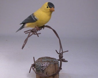American Goldfinch on barbed wire Hand Carved Wooden bird