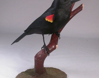 Red-winged Blackbird Wooden carved Bird on wooden carved branch