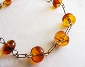 Sterling silver and honey-colored Baltic amber beaded bracelet