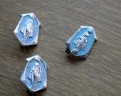 Three aluminum miraculous medal pins