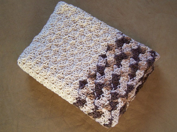 Crochet baby blanket in light beige with side borders in variegated shades of brown