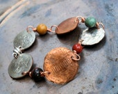 Hand hammered penny and dime bracelet