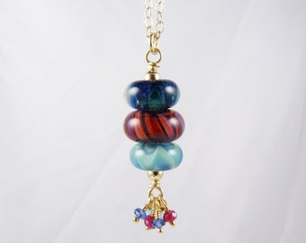Boro Lampwork Glass Bead Stack Necklace with Rubies, Blue Kyanite, Aqua Apatite, and Gold on a Long Gold Chain