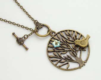 Antiqued gold brass bird birdie on tree of life branch necklace blue glass flower pendant jewelry design by Steampunk Nation R1062