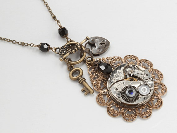Steampunk necklace vintage silver watch movement gears gold filigree flower heart lock skeleton key black crystal by Steampunk Nation 1524