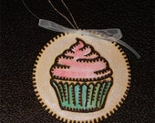 Custom wood burned cupcake ornament with name on back