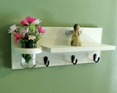 Shelf with mason jar and key hooks and jar