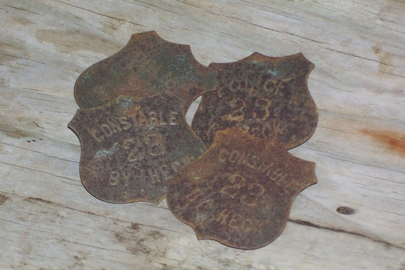 Rusted toy tin police badges mixed media supplies