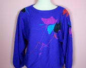 SALE & FREE Shipping  VNTG 80s rich royal blue slouchy sweater with purple red turquoise and black abstract decals