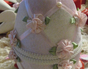 Easter Egg Large Pink white pearls ribbon velvet and pastel pink flowers with green ribbon leaves It stands opens lined in satin nice condition gimp trim ivory Spring Gift box  Handmade