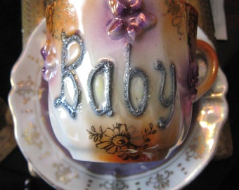 GERMAN BABY Demi Lustre Cup Saucer Porcelain Reads Baby Purple Flowers Orange Creamy White and Gold