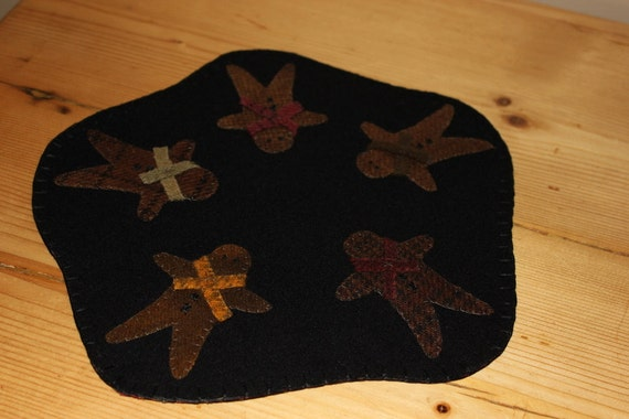 Primitive gingerbread man wool candle mat