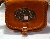 Beautiful Leather Braided Purse with Victorian decorative badge