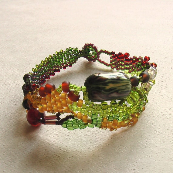 Organic freeform peyote series Seed beaded free form bracelet in shades of green and brown with agate bead and handmade polymer clay bead