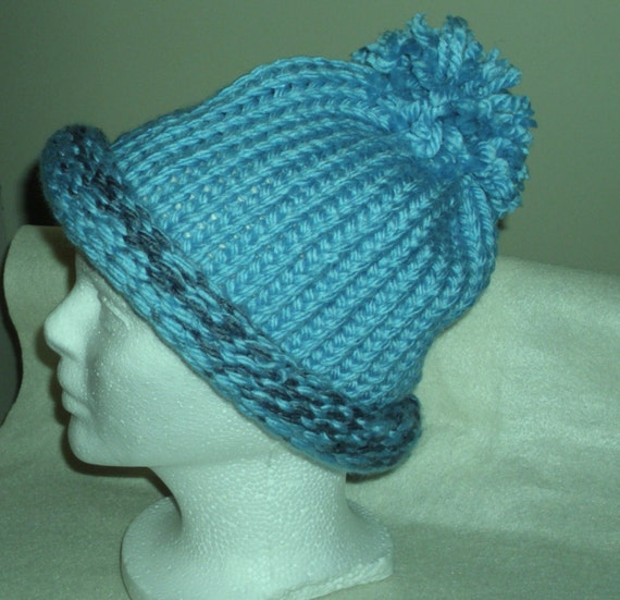 Hand knitted hat- aqua/teal- with tassel.