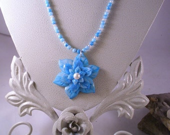 Turquoise blue triple layer shell flower with shell and pearl beads