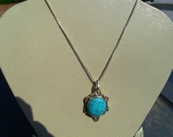 Reconstituted Turquoise in a silver setting with a German Silver Chain