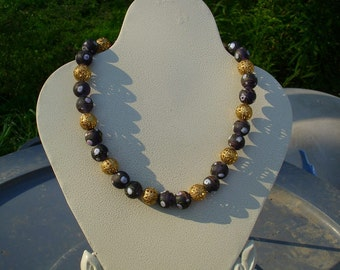 Black glass flower beads with large gold filigree beads