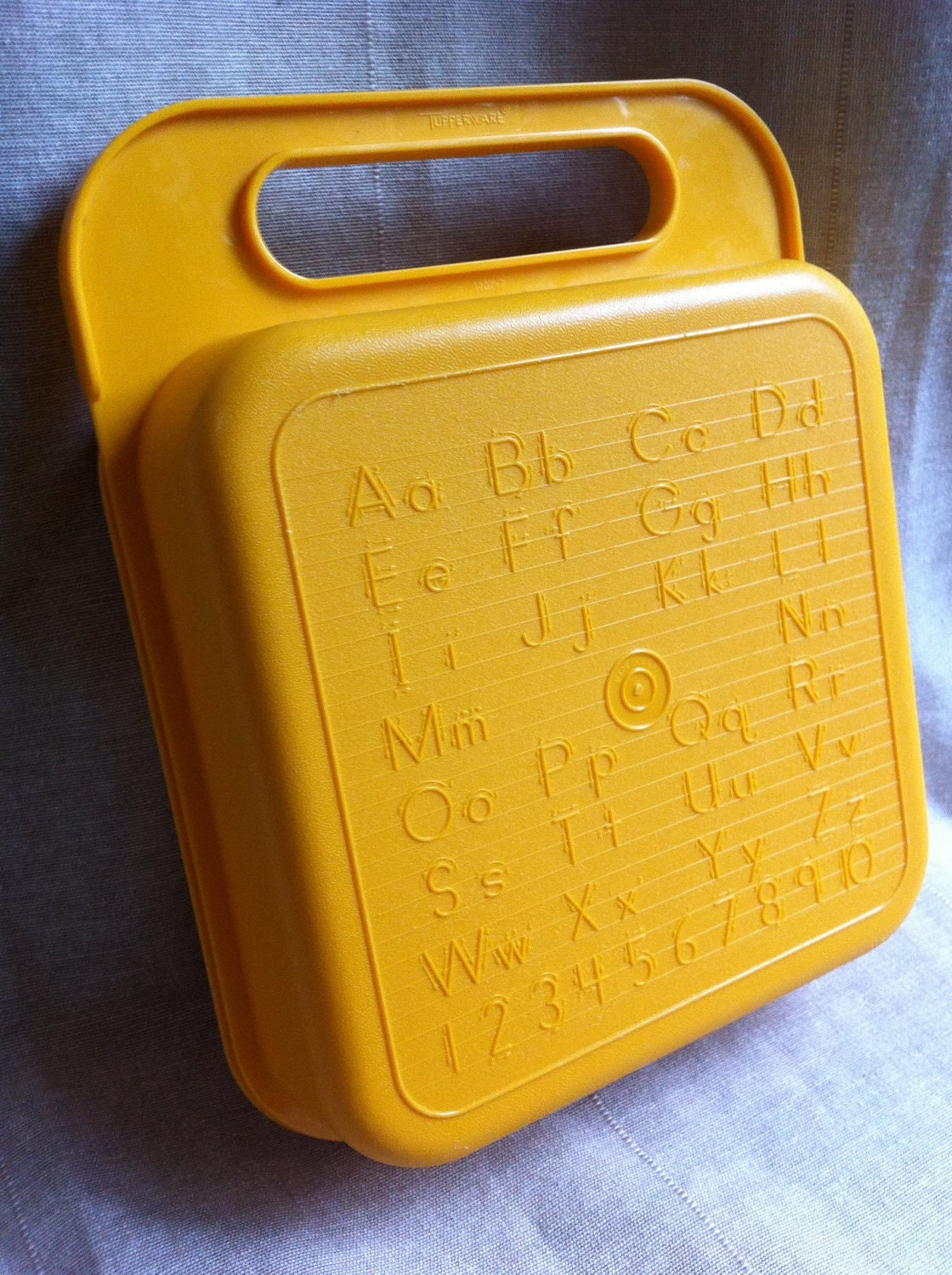 childrens yellow tupperware school supply box with alphabet. Black Bedroom Furniture Sets. Home Design Ideas