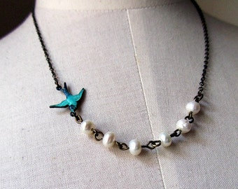 white fly bird patina bird with pearl antique broze necklace