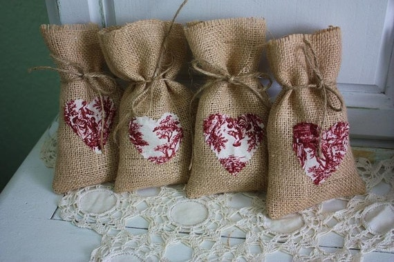 Burlap gift bags with red toil hearts