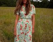 Vintage 1970s scoop neck, A-line floral print dress.