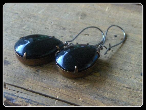 Wolf's Blood in her veins. Vintage black glass teardrop cabochon earrings