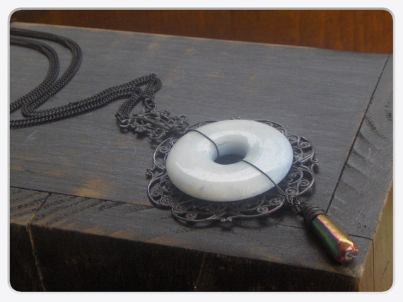 The Haunt Of The Blue Lady.  Light Blue Agate donut and Gothic black elements necklace