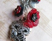 Maraca Playing Skeleton Necklace with Red and Black Flowers