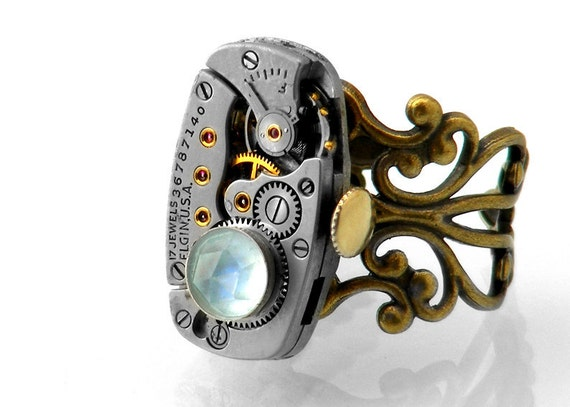 RESERVED FOR EM - Sky Blue Topaz Steampunk Ring with Vintage Elgin Watch Movement / Gemstone Ring / Adjustable Ring