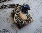 SECRETS - Locket necklace with brass book, skeleton key charm and swarovski crystal