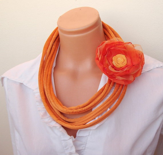 Orange fabric loop necklace with flower brooch