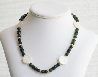 White Mother of Pearl and Dark Green Glass Beads