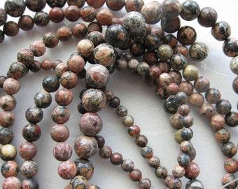 6mm Leopardskin Jasper Round Beads - 16 inch strand