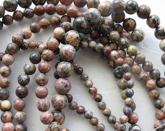 10mm Leopardskin Jasper Round Beads - 16 inch strand