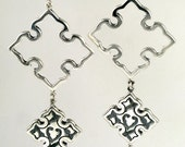 Handmade (cast) sterling silver dangling earrings with Ruby drops