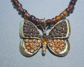 RESERVED Brown Necklace Glass and Butterfly Charm