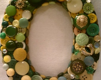 """Green and Yellow """"O""""  Button Initial"""