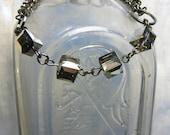 Loretta- Blue Meridian Swarovski Cubes and Gunmetal Chain