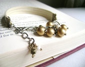 Inspire me - golden beads ivory faux leather charm bracelet