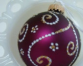 White Swirls with Gold Accents on Burgandy Glass Ornament