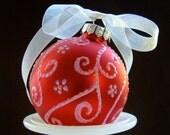 Pale Plnk Swirls on Red Glass Ornament
