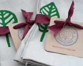 stamped leaf napkins - pine green on smoke