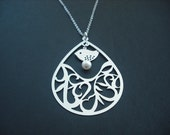 Matte Arabesque Pattern Teardrop necklace - white gold plated