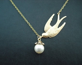 a bird with treasure - yellow  gold version