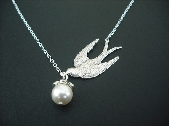 a bird with treasure - white gold plated chain