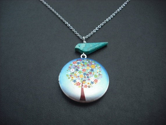 matte silver flower tree locket with turquoise bird necklace